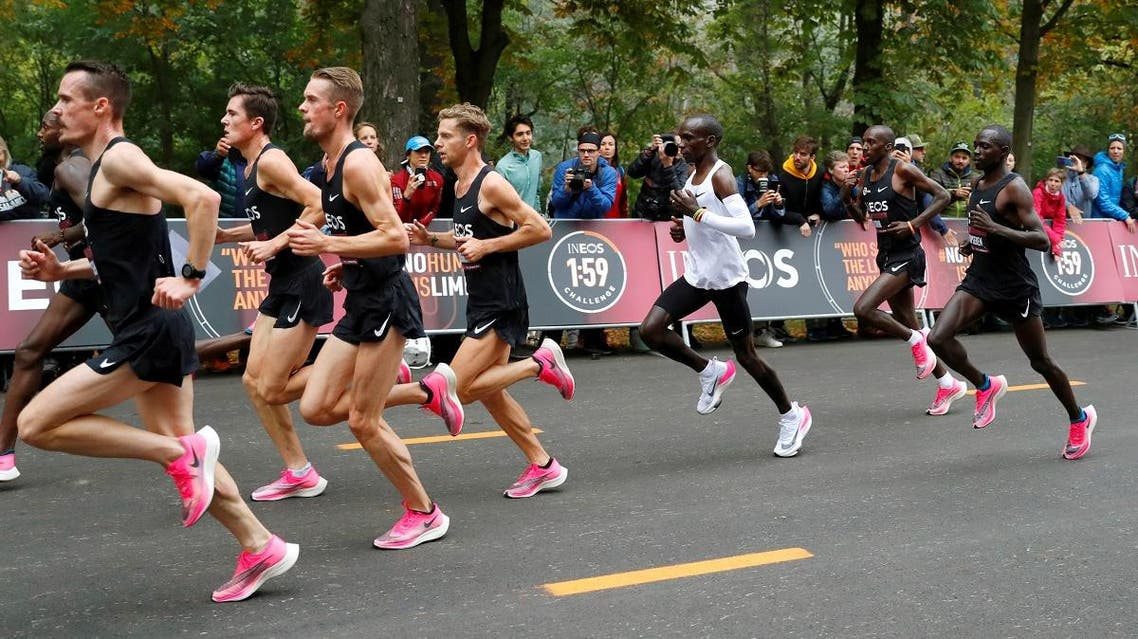 Kenya's Eliud Kipchoge, the marathon world record holder, runs wearing Nike Vaporfly shoes with his pacemakers during his attempt to run a marathon in under two hours in Vienna, Austria, October 12, 2019. (Reuters)