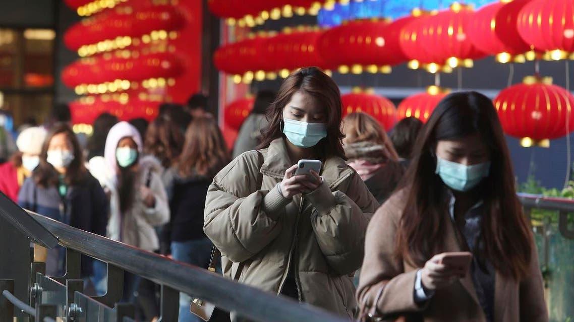 People wear face masks and walk at a shopping mall in Taipei, Taiwan, Friday, Jan. 31, 2020. (AP)