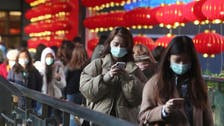 China chides 'mean' US for travel warning as virus impact spreads