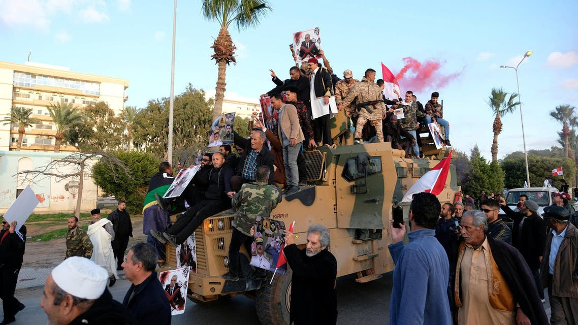 Supporters of Libyan National Army (LNA) commanded by Khalifa Haftar, celebrate on top of a Turkish military armored vehicle, which LNA said they confiscated during Tripoli clashes, in Benghazi, Libya January 28, 2020. (Reuters)