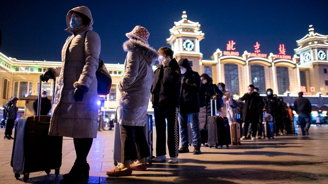 Passengers, wearing protective facemasks, start to arrive from the provinces at the Beijing Railway Station on January 30, 2020.  (AFP)