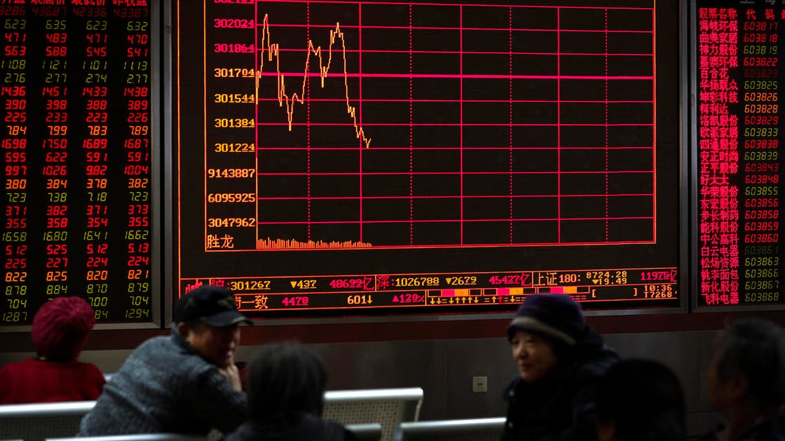 Chinese investors check stock prices at a brokerage house in Beijing. (AP)