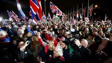 Flag-waving Britons stage noisy Brexit welcome outside parliament