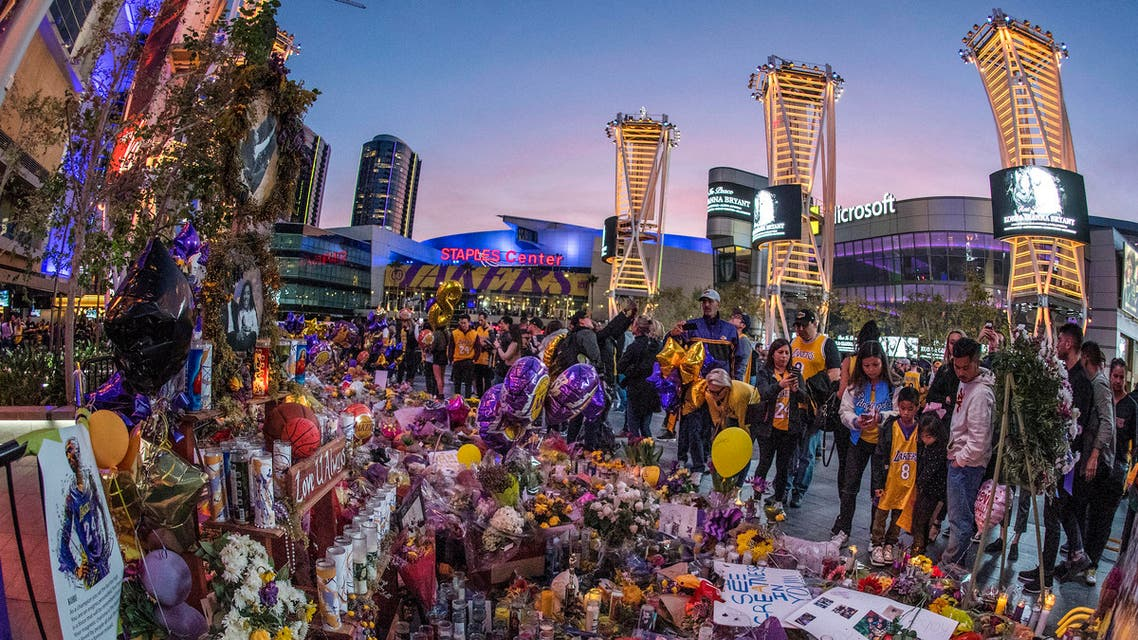 Lakers fans pay their respects at a Staples Center memorial to NBA legend Kobe Bryant (AFP)