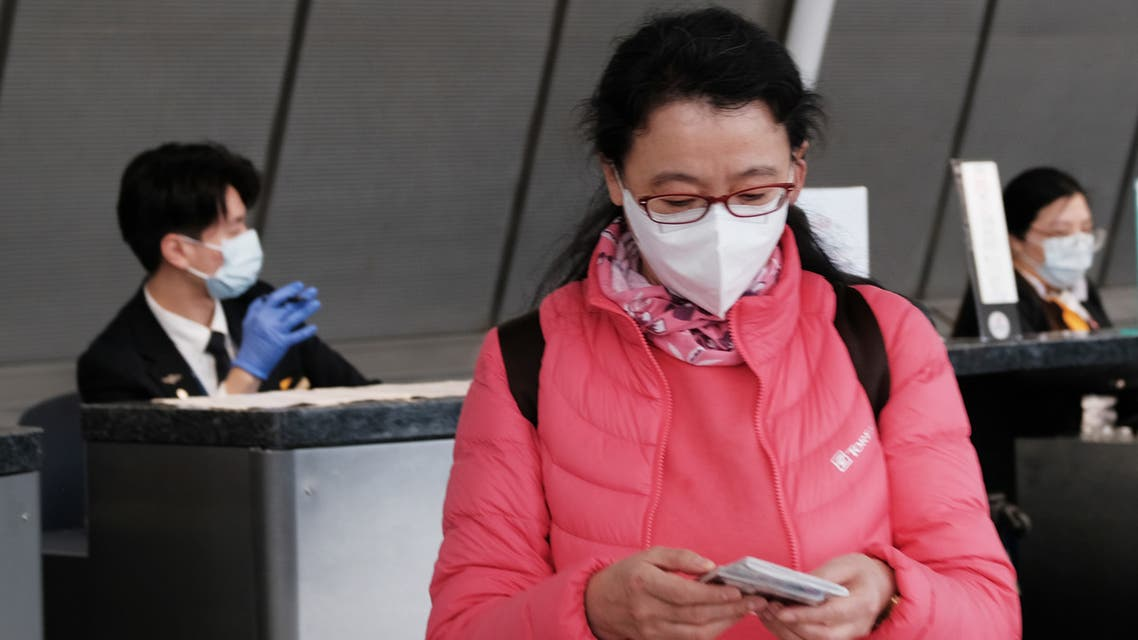 NEW YORK, NEW YORK - JANUARY 31: At the terminal that serves planes bound for China, people wear medical masks at John F. Kennedy Airport (JFK) out of concern over the Coronavirus on January 31, 2020 in New York City. The virus, which has so far killed over 200 people and infected an estimated 9,900 people, is believed to have started in the Chinese city of Wuhan. Spencer Platt/Getty Images/AFP