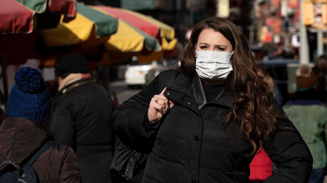 A woman, who declined to give her name, wears a mask, on January 30, 2020, in New York. (AP)