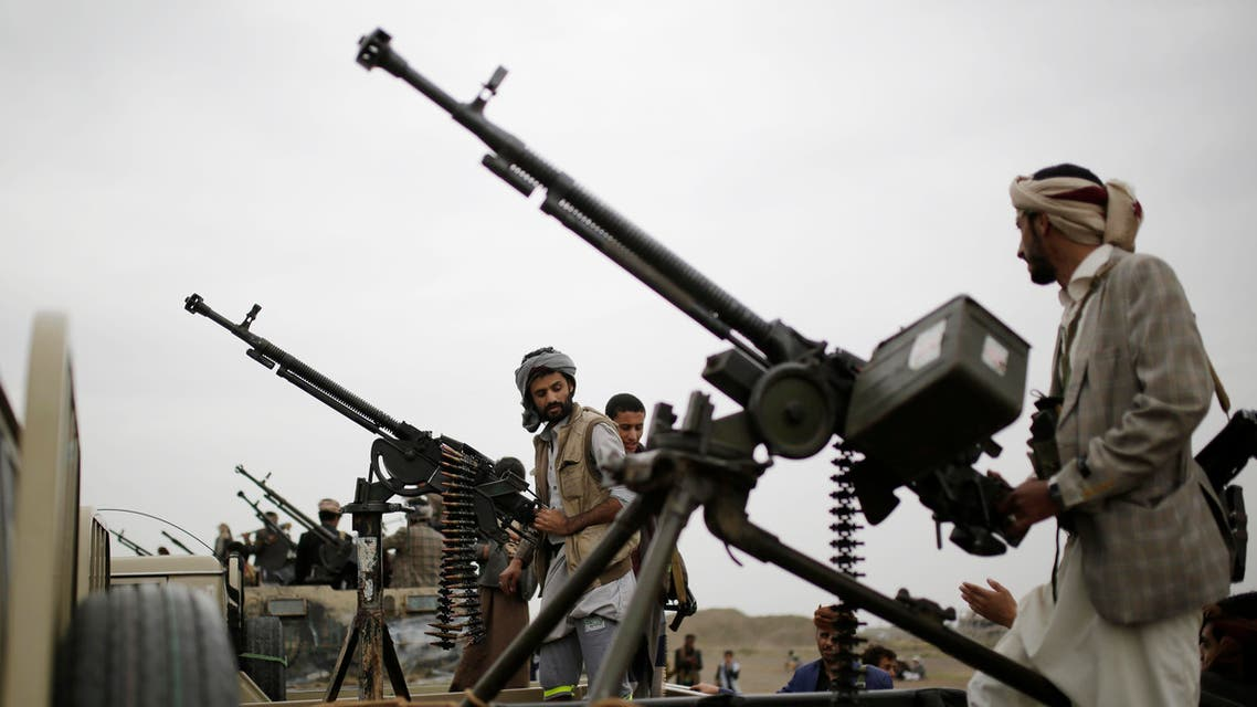 Houthi rebel fighters ride on trucks mounted with weapons, during a gathering aimed at mobilizing more fighters for the Houthi movement, in Sanaa (AP)