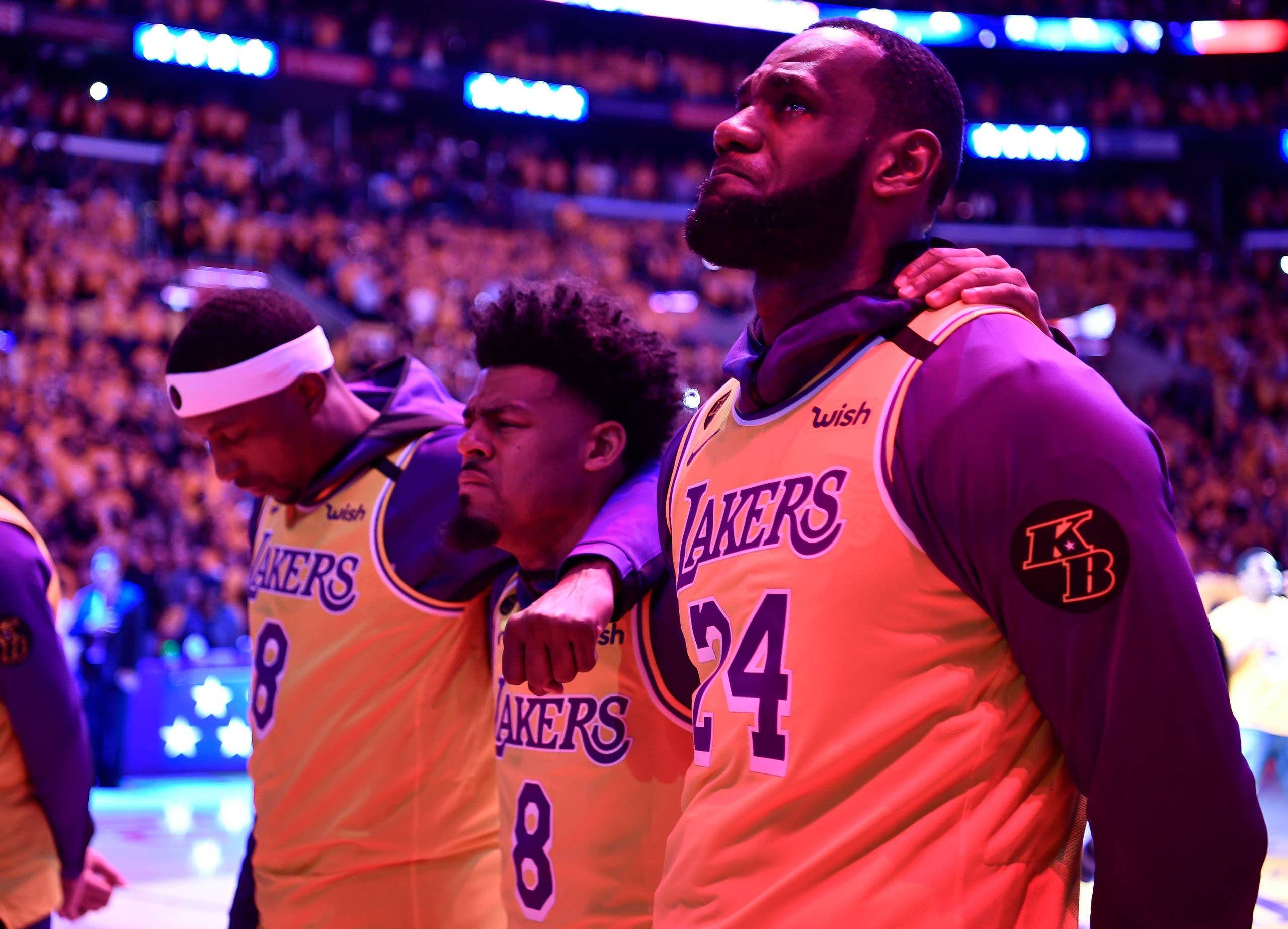 Los Angeles Lakers forward LeBron James reacts during the national anthem after a pre game tribute to Kobe Bryant before playing the Portland Trail Blazers at Staples Center. (Reuters)