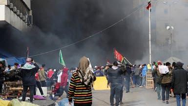 انفجار عبوة صوتية ببغداد.. وأنصار الصدر يقمعون المحتجين