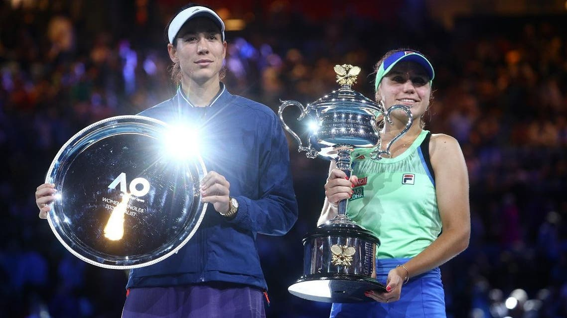 Sofia Kenin (right) of the US and Spain's Garbine Muguruza pose with the trophies after their Australian Open Women's Singles Final in, Melbourne, Australia, on February 1, 2020. (Reuters)