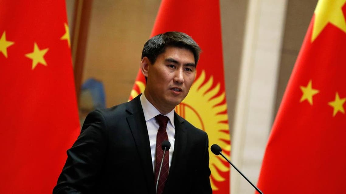 Kyrgyzstan's Foreign Minister Chingiz Aidarbekov and his Chinese counterpart Wang Yi speak to reporters during a joint press conference at the Diaoyutai State Guesthouse in Beijing on February 21, 2019. (AFP)
