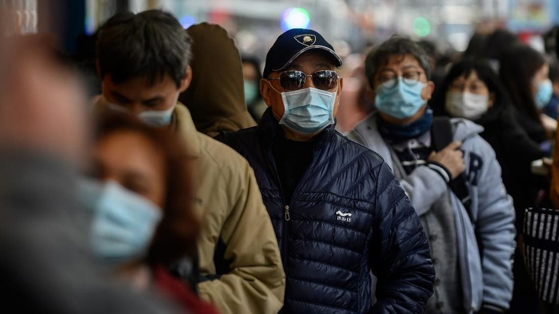 People queue to buy face masks from a shop in Hong Kong on February 1, 2020. (AFP)