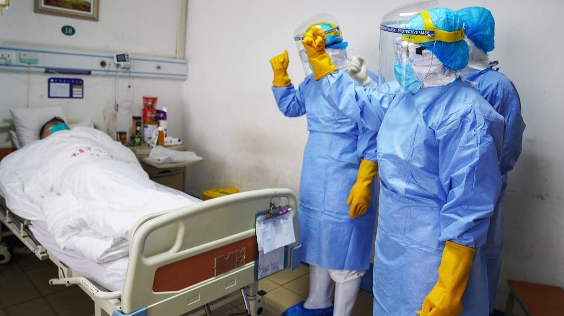 This photo taken on January 28, 2020 shows medical staff members cheering up a patient infected by the novel coronavirus in an isolation ward at a hospital in Zouping in China's easter Shandong province. (AFP)