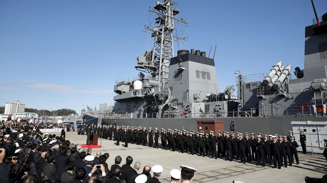 """Japan's Prime Minister Shinzo Abe (center L) speaks during a ceremony to mark the departure of Japan's Maritime Self-Defense Force destroyer """"Takanami"""" for the Middle East. (Photo: AFP)"""