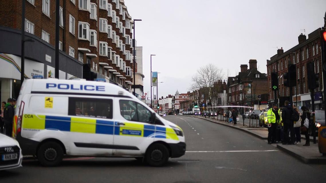 Police at the scene after an incident in Streatham, London, Sunday Feb. 2, 2020. (AP)