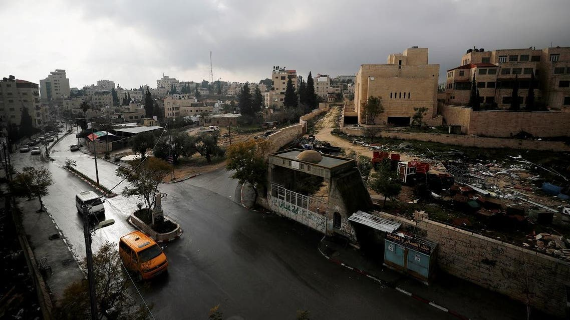 An abandoned Palestinian parliament building is seen in a general view picture of the Palestinian town of Abu Dis in the Israeli-occupied West Bank, east of Jerusalem. (Reuters)