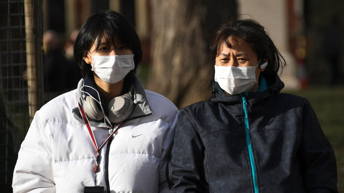 Two women wearing masks in Parliament Square, in London, Saturday, Feb. 1, 2020. (AP)