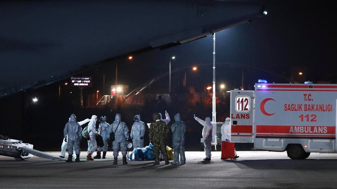 Medical personnel work around a military plane at the airport in Ankara, Turkey, on February 1, 2020, shortly after it landed after flying from Wuhan, China. The Turkish government evacuated 42 people amidst the gathering nationwide concern on Coronavirus. (AP)