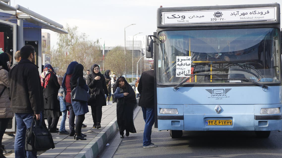 Iranians stand at a bus stop on a main road in Tehran on January 3, 2018. (File photo: AFP)