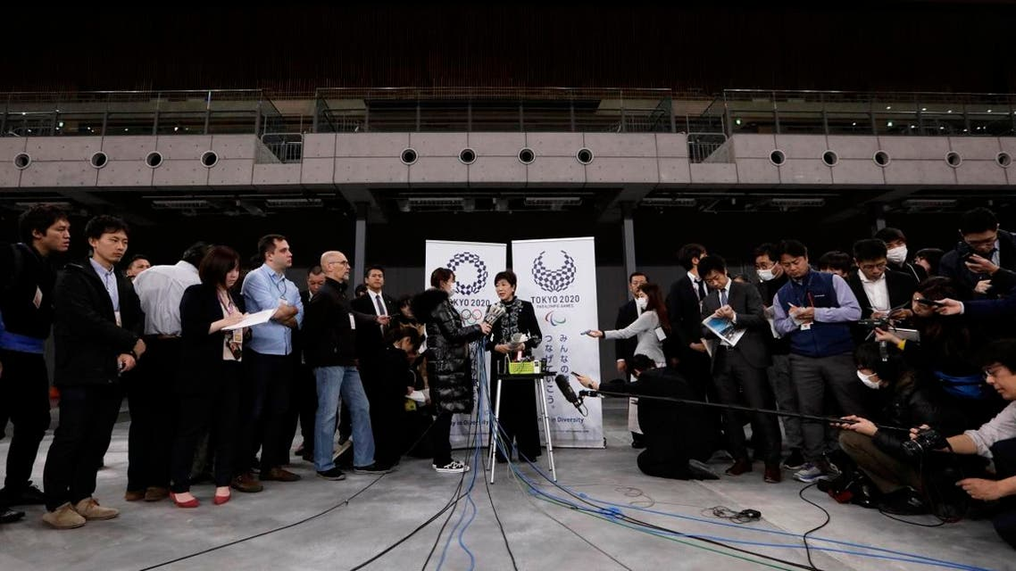 Tokyo Gov. Yuriko Koike, center, talks to reporters after a grand opening ceremony of the Ariake Arena. (Photo: AP)