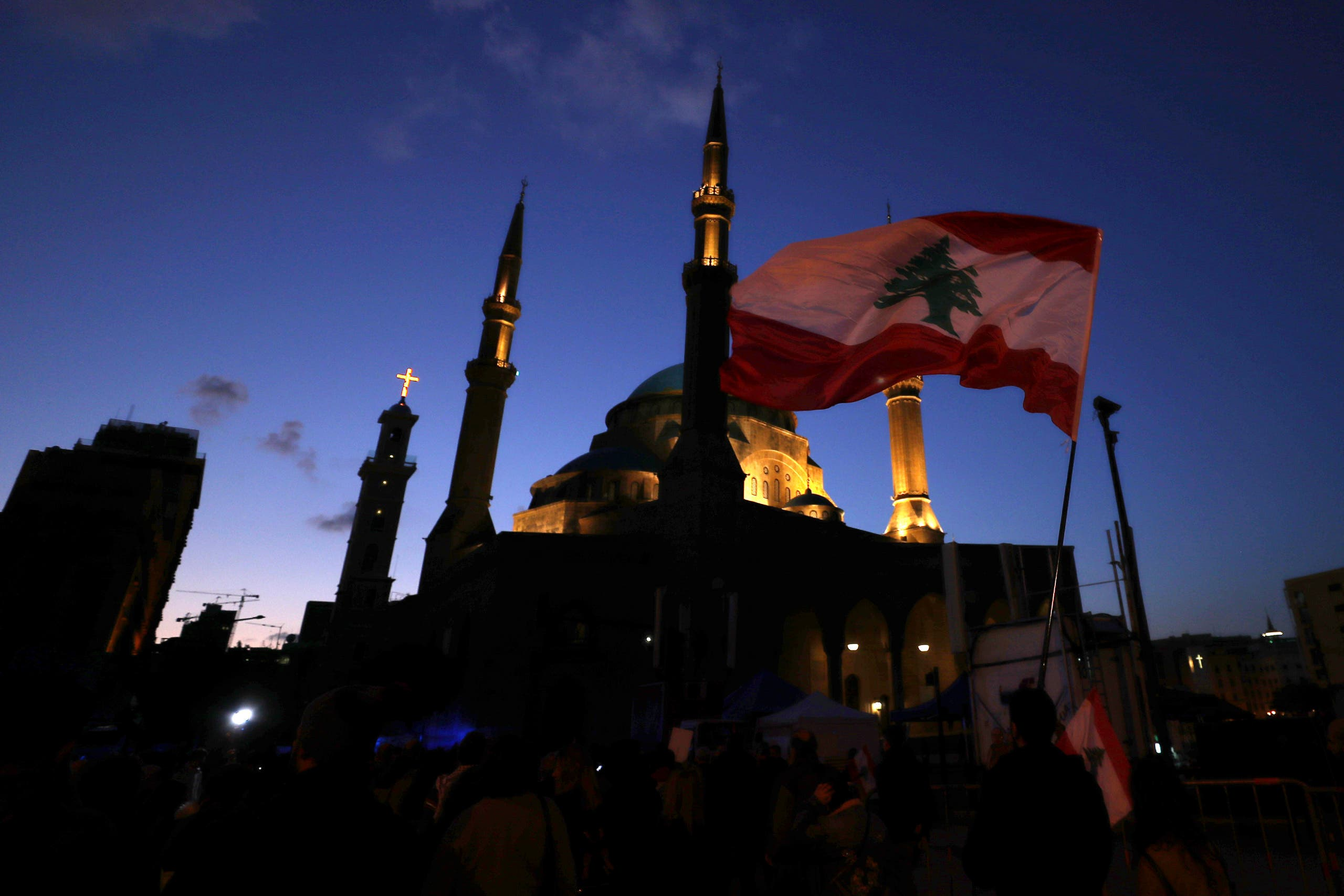Anti-government protesters wave Lebanese flags and chant slogans, during ongoing protests against the Lebanese government, in Beirut, Lebanon, Saturday, Feb. 1, 2020.(File photo: AP)