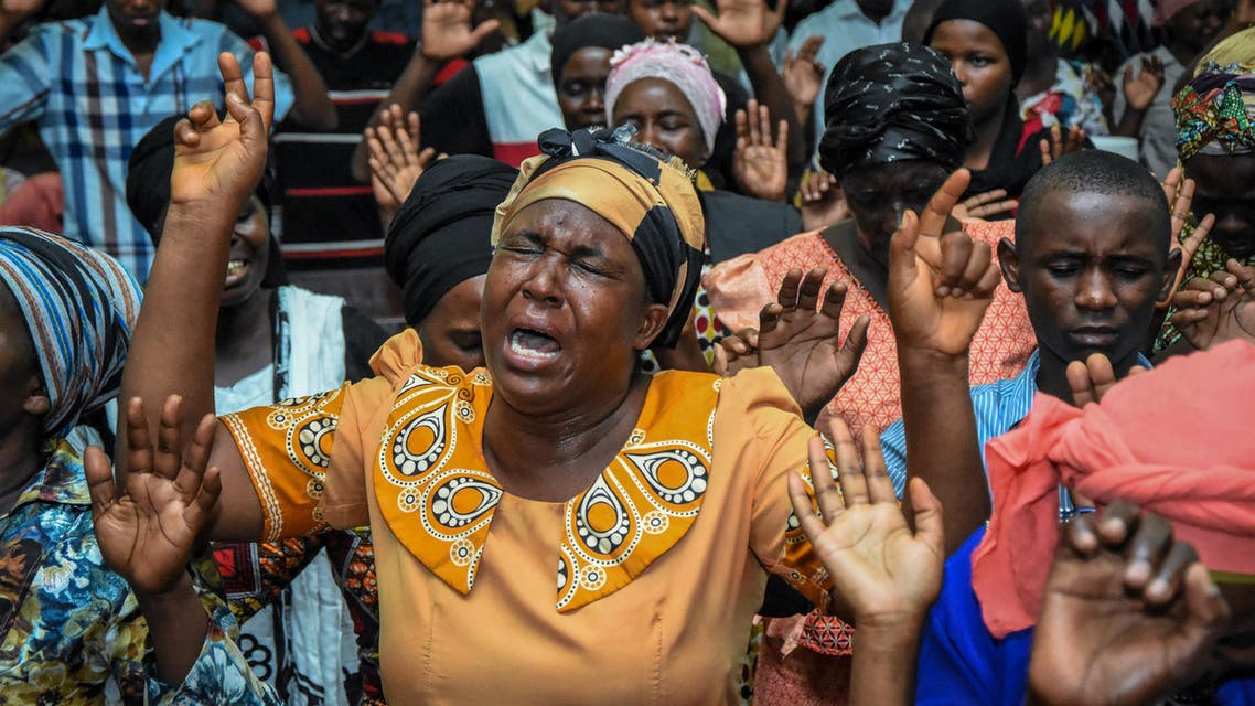 Believers immerse in prayer during a special mass held to usher in the New Year at Full Gospel Bible Fellowship church in Dar es Salaam, Tanzania, on January 1, 2020. Ericky BONIPHACE / AFP