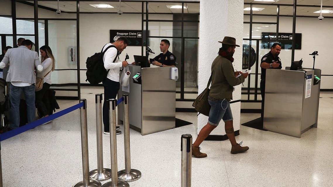 MIAMI, FL - FEBRUARY 27: U.S. Customs and Border Protection officers use facial recognition technology in their booths at Miami International Airport to screen travelers entering the United States on February 27, 2018 in Miami, Florida. The facility is the first in the country that is dedicated to providing expedited passport screening via facial recognition technology, which verifies a traveler's identity by matching them to the document they are presenting. Joe Raedle/Getty Images/AFP