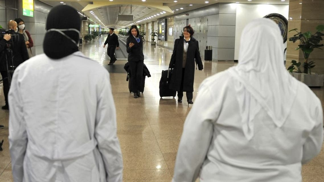 مطار القاهرة الدولي فحص حراري للمسافرين خوفا من انتشار كورونا- فرانس برس
