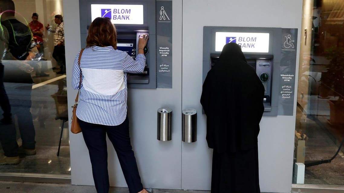 Women use ATMs at Blom bank in Beirut, Lebanon. (Reuters)