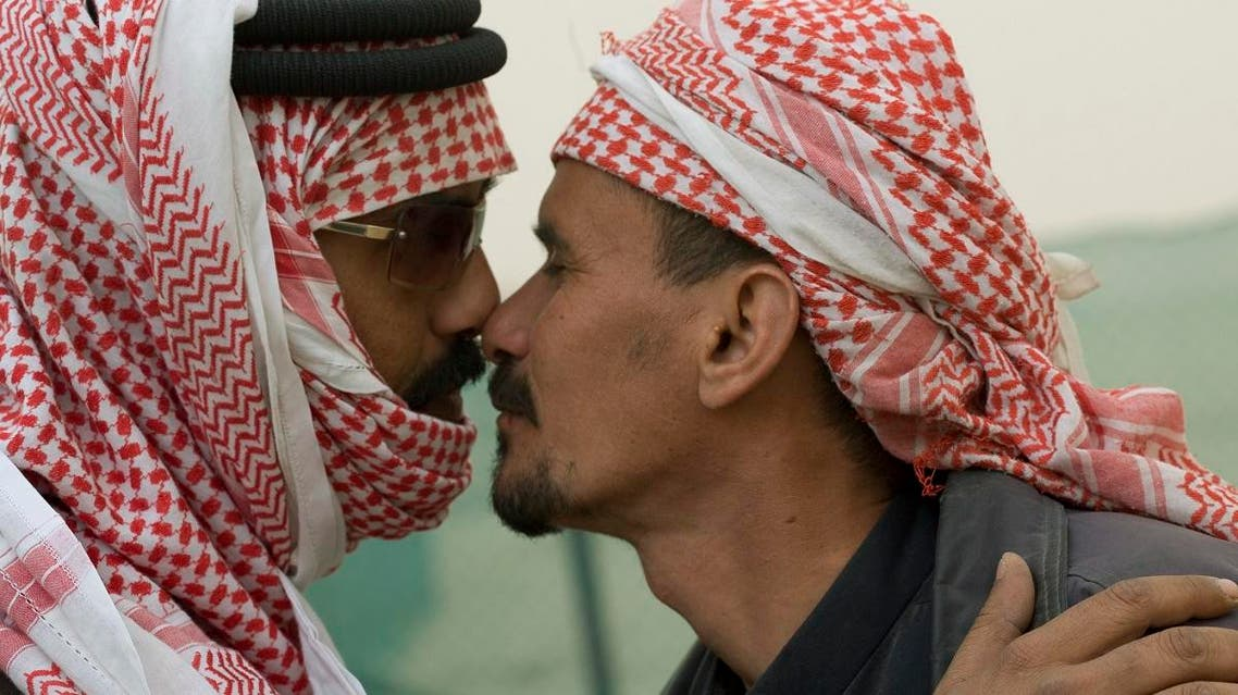 Two Gulf Arab men greet each other in the traditional tribal (Bedoine) fashion by touching each other's nose. (File photo: Reuters)