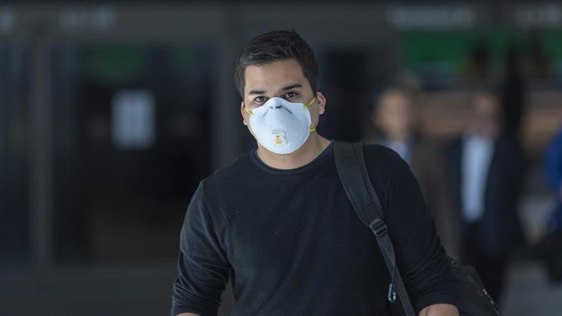 Travelers arrive to LAX Tom Bradley International Terminal wearing medical masks for protection against the novel coronavirus outbreak. (AFP)