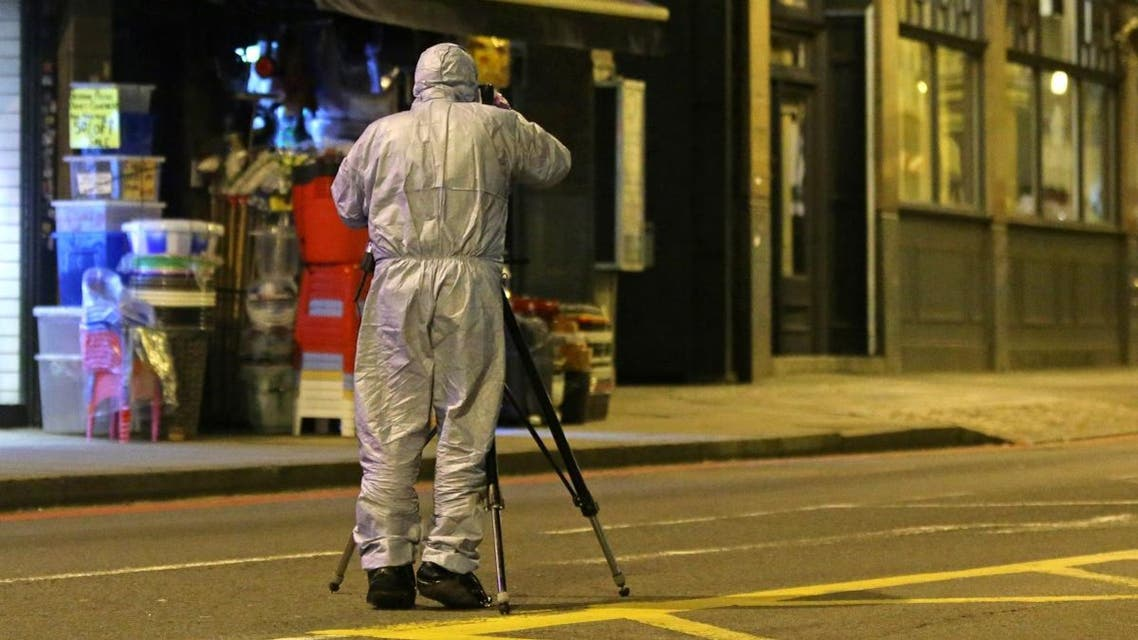 A police forensic officer works on Streatham High Road in south London on February 2, 2020, after a man is shot dead by police following reports of people being stabbed in the street. (AFP)
