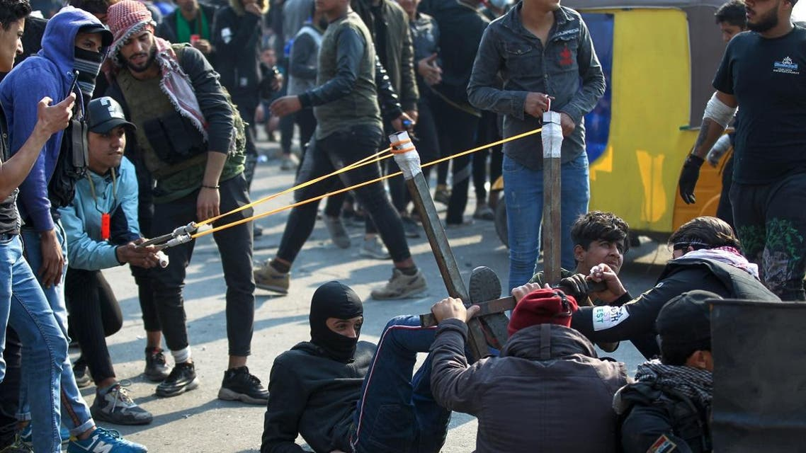 Iraqi protesters use a slingshot to hurl rocks during clashes with security forces following a demonstration at Al Wathba square in the capital Baghdad, on January 30, 2020. (Photo: AFP)