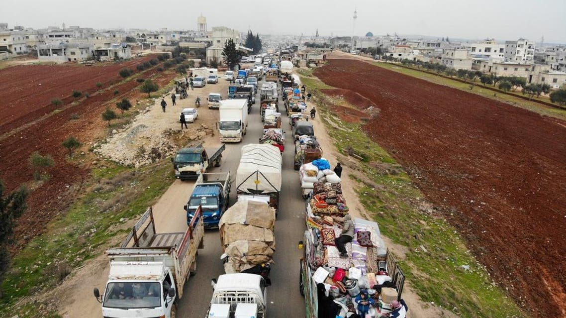 displaced Syrians driving through Hazano in the northern countryside of Idlib, after fleeing on January 28, 2020 its southern countryside towards areas further north near the border with Turkey. afp