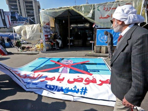 محتجو العراق يجددون رفض علاوي.. قبعات حمراء مقابل الزرقاء