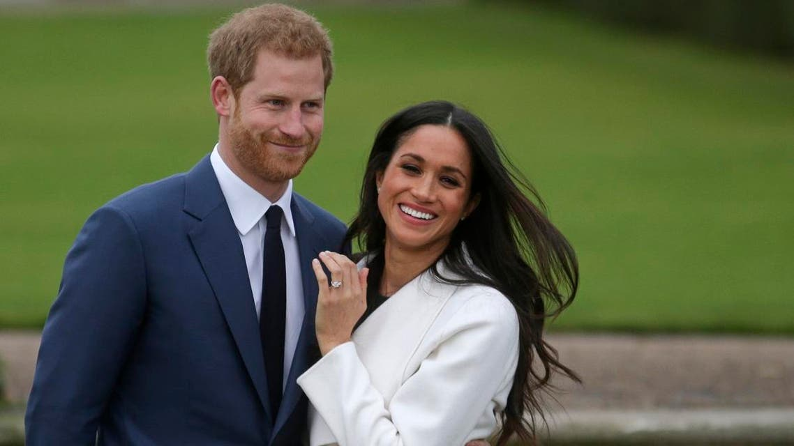 In this file photo taken on on November 27, 2017, Britain's Prince Harry stands with his fiancee US actress Meghan Markle as she shows off her engagement ring. (Photo: AFP)