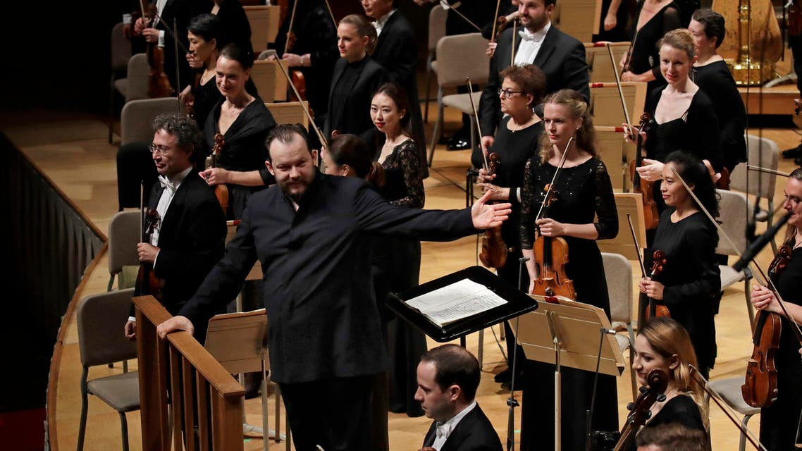Andris Nelsons gestures towards the musicians prior to conducting a joint concert of the Boston Symphony Orchestra and Germany's visiting Leipzig Gewandhaus Orchestra at Symphony Hall in Boston. (AP)