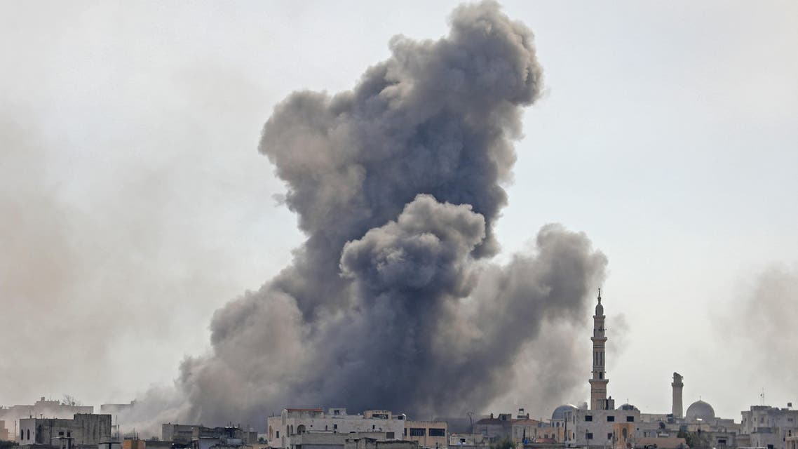 Smoke plumes billowing in the Syrian village of al-Nayrab, southeast of the city of Idlib. (AFP)
