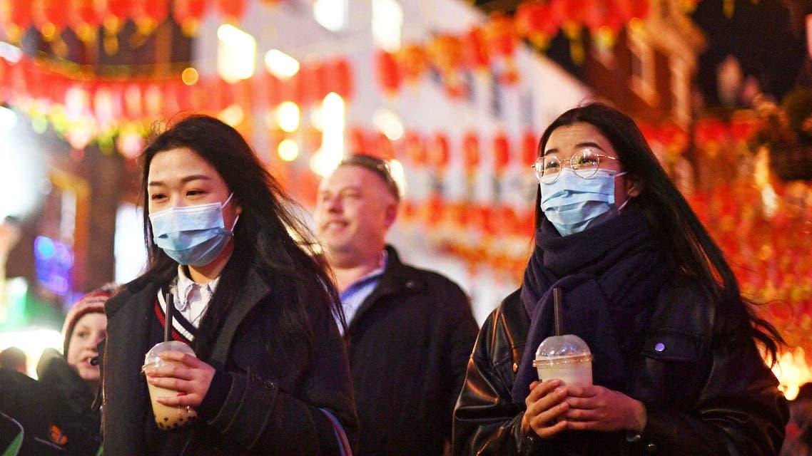 People wearing masks walk in China Town, in London, Saturday, Feb. 1, 2020. (AP)