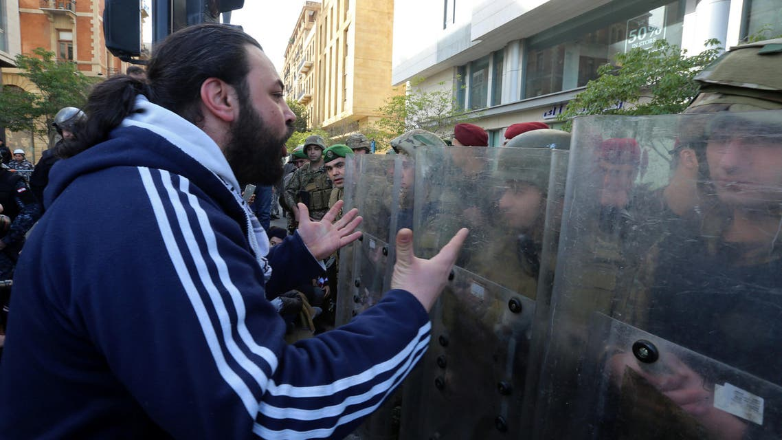 A protestor gestures at Lebanese soldiers during a protest against the political elite in Beirut, Lebanon January 27, 2020. (Reuters)