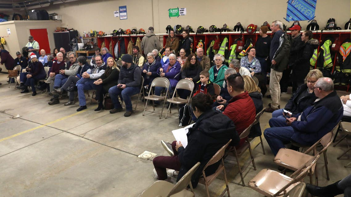 People wait for a caucus in a fire station in Kellogg, Iowa. (Reuters)