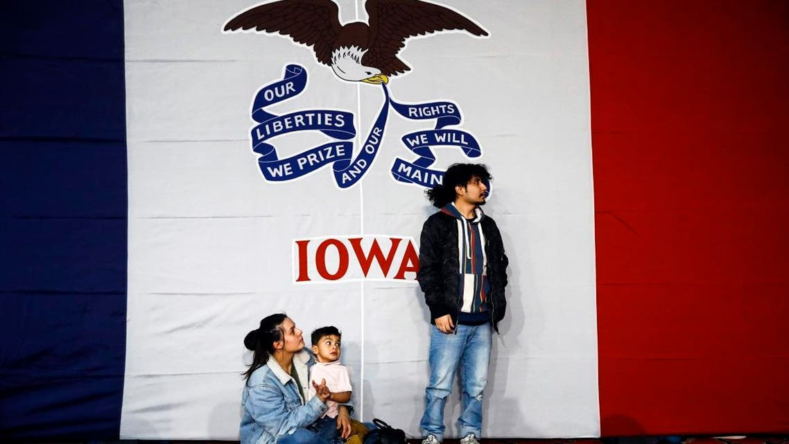 Natalie Serrano, left, and Isaac Garcia watch caucus returns come in with their son Leonel, 2, at a caucus night campaign rally in Des Moines, Iowa, Monday, Feb. 3, 2020.  (Photo: AP)