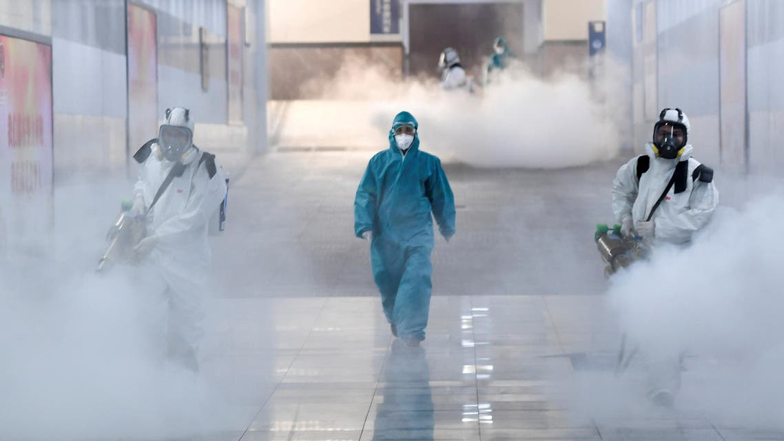 Volunteers in protective suits disinfect a railway station as the country is hit by an outbreak of the new coronavirus, in Changsha, Hunan province, China February 4, 2020. (Reuters)