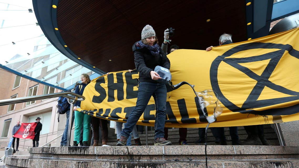 Activists block the entrance to oil giant Shell's headquarters, saying the company's plans to continue investment in developing new sources of gas and oil show the company is not taking the threat of climate change seriously in The Hague, Netherlands. (Reuters)