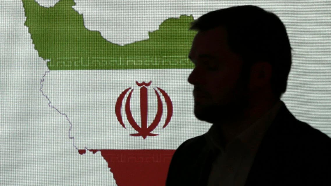 Stuart Davis, a director at one of FireEye's subsidiaries, stands in front of a map of Iran as he speaks to journalists about the techniques of Iranian hacking on Sept. 20, 2017 in Dubai. (AP)