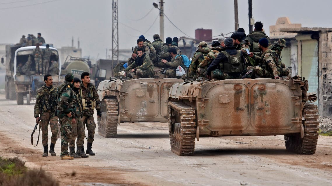 Syrian army soldiers advance in Tall Touqan village, in Syria's northwestern Idlib province, about 45 kilometres southwest of Aleppo, on February 5, 2020. Syrian regime forces pressed on with their offensive in the northwest that has displaced half a million people, despite heightened tensions with Turkey.
