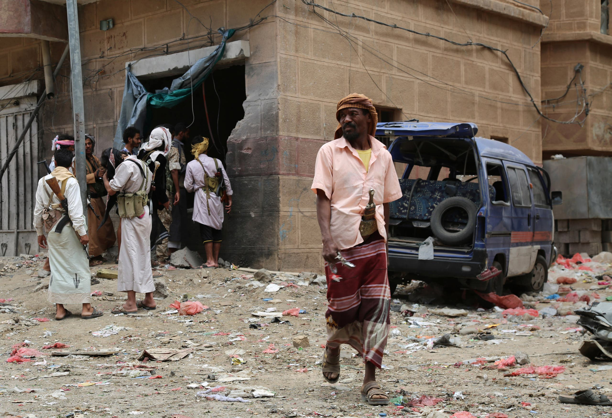 Yemenis look at the damage after Iran-backed militia fired Katyusha rockets at a busy market in Yemen's Marib province, east of the capital, Sanaa, on September 11, 2015. (Reuters)