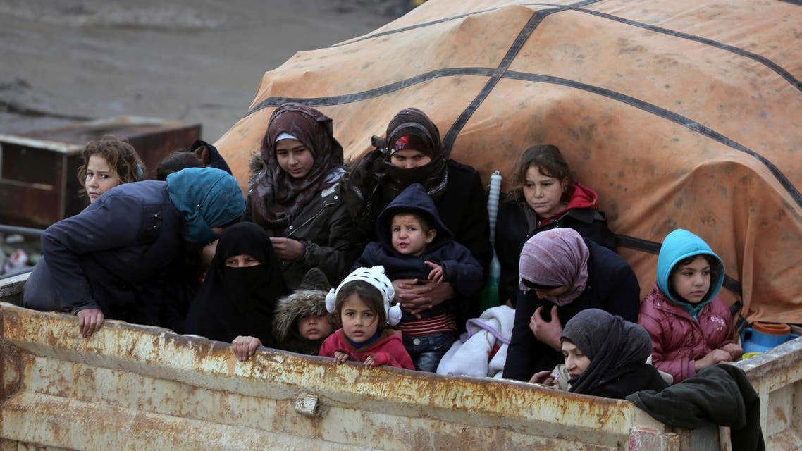 Syrians sit in the back of a truck as they flee the advance of the government forces in the province of Idlib on Jan. 30, 2020. (Photo: AP)