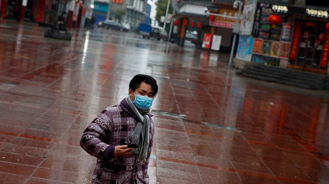 A man wearing a face mask walks in a deserted shopping area in Jiujiang, Jiangxi province, China, as the country is hit by an outbreak of the novel coronavirus. (Reuters)