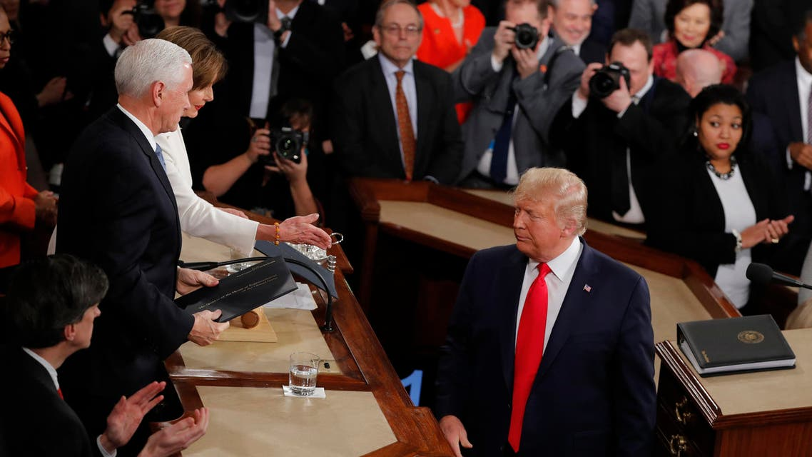 President Donald Trump turns after handing copies of his speech to House Speaker Nancy Pelosi of Calif., and Vice President Mike Pence. (AP)